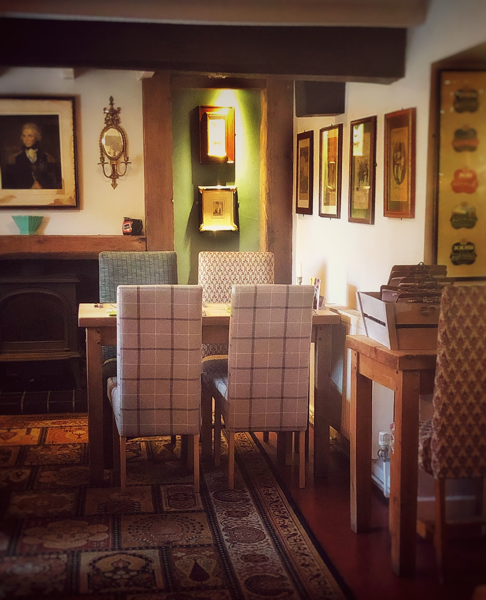 Cosy village pub table and chair woodburner